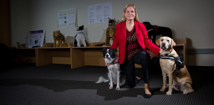 Melody Moore Jackson with her dog communication devices
